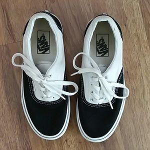 Vans low top black and white sneakers size 7.5